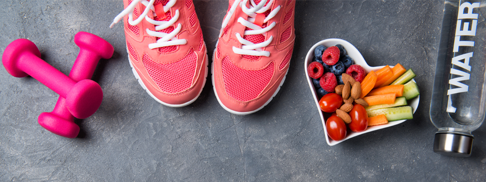 Gym shoes, weights, bowl of fruit and water